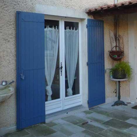 Porte-fenêtre en bois à 2 vantaux